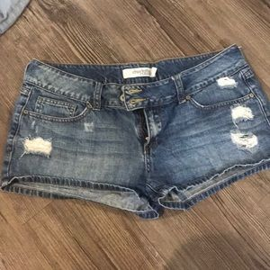 Charlotte Russe double button distressed shorts